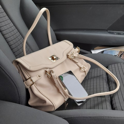 Hangbag and phone left visible on car seat